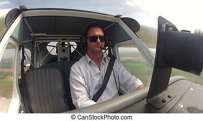 Pilot in the cockpit of airplane - Pilot flying in the...