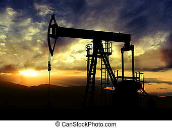 Oil pump on sunset background - Oil pump jack.Oil industry...