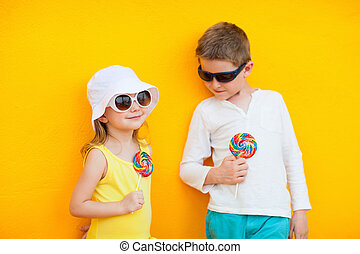 Kids with lollipops - Adorable little kids with colorful...