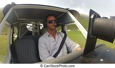 Pilot in the cockpit of airplane