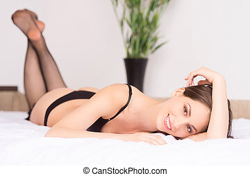 Woman in lingerie Beautiful young women in lingerie lying...