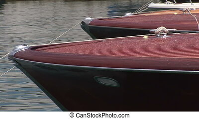 Bows of docked boats - Bows of wooden vintage motor boats