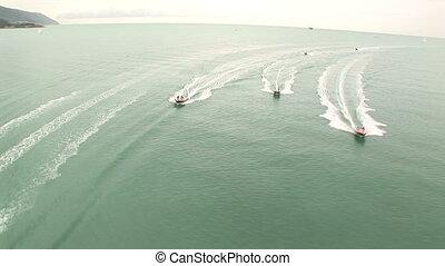 Vintage motorboat racing in the sea