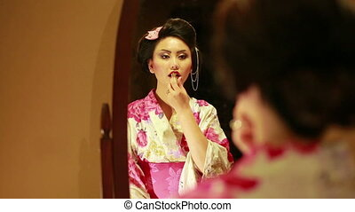Make up of Japanese geisha - Japanese geisha making up on...