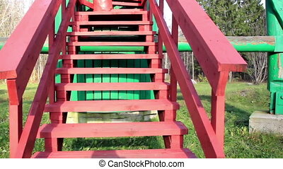 Going up in the red stairs found in the middle of the open...