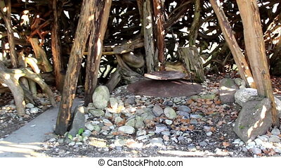 In witch house hut wooden sticks and some big roots...
