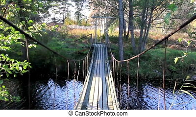 Walking steadily on the hanging bridge while you can see...