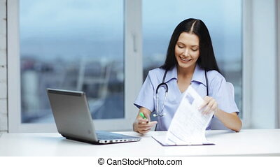 doctor or nurse with laptop pc writing prescription -...