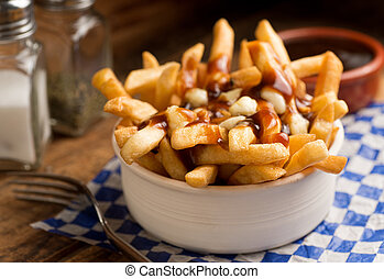 Poutine - Classic French Canadian poutine with french fries,...
