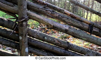 Old wood used as fence. The fence used to fence the area is...