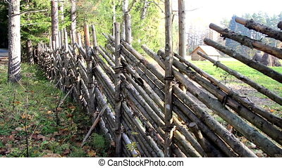 Fence made out of wood that has fenced the whole open area...