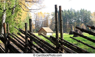 Closer image of the cabin log within the fence