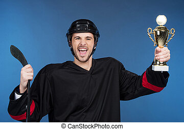 Happy winner holding cup. Celebrating his victory, Isolated...