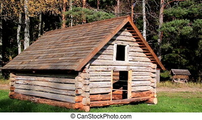 Cabin log and its roof made of wooden tiles. Cabin log is...