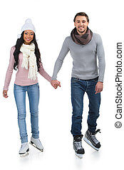 Loving couple skating together holding hands. Isolated on white