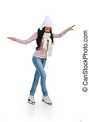 Nice African teenage girl trying to do figure skating. Full length isolated on white