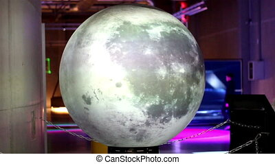 Miniature moon on display in the science fair where children...