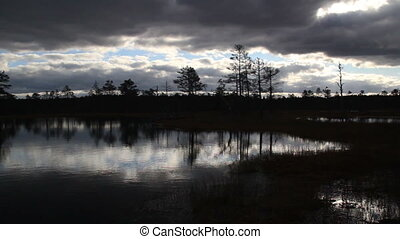Sundown view of the bog swamp marsh land - Sundown view of...