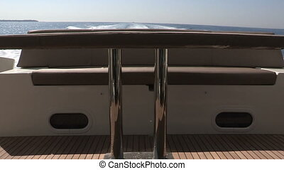 Table and sofa on running boat
