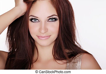 Positively smiling young girl with blue eyes and long hair...