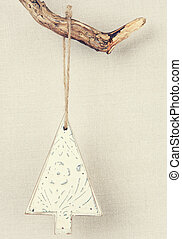 Vintage christmas decoration hanging on the branch