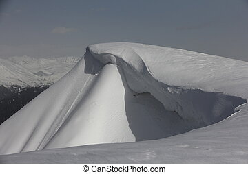 Snow cornice in mountains of Caucasus, Russia Avalanche...