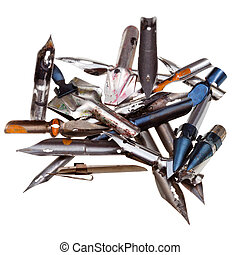 heap of used metal drawing pens isolated on white background