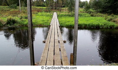 Four long wooden planks used to make hanging bridge floor...