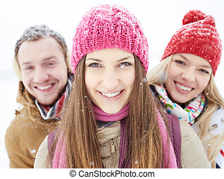 Girl in winterwear - Portrait of happy friends looking at...