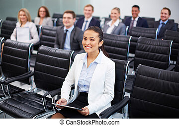 Business lecture - Image of business people sitting in rows...