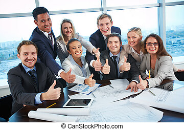 Happy co-workers - Group of business partners showing thumbs...