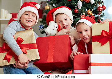 Christmas kids - Group of three little boys in Santa caps...