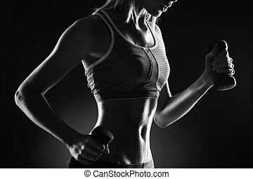 Exercise - Body of slim female in activewear doing exercise...