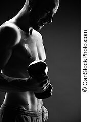 Physical exercise - Image of handsome man with bare torso...