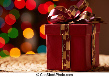 Red giftbox - Image of red Christmas giftbox on wattled tray