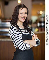 Happy Waitress Standing In Cafe - Portrait of happy young...