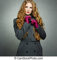Portrait of young woman in autumn coat Fashion photo