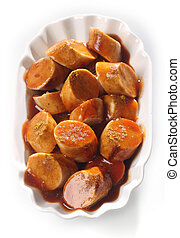 Currywurst - Overhead view of a dish of sliced grilled spicy...
