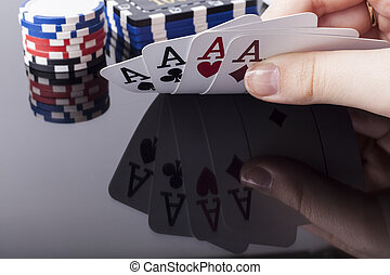 Holdin Aces - Woman holds aces poker cards with reflection...