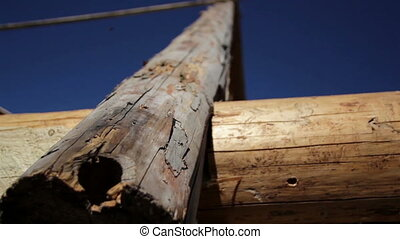 Logs used in building old historic cabin log house - Logs...