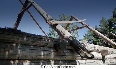 Closer image of the unfinished old historic cabin log house...