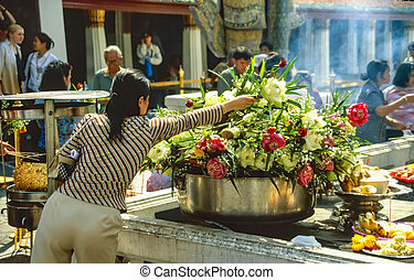 Flower donation in Buddhist temple