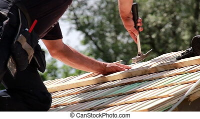 Roofers installing cedar wooden shingle roof - Roofers...