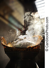 Hot wooden steamer above the pot - Sticky rice being cooked...