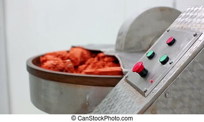 Sausage production - Mixing mince meat with spices