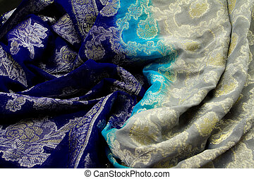 Blue and silver satin textile background close up