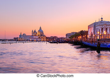 Venice, Italy. Gondolas on Grand Canal at sunset. Basilica...