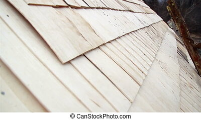 Cedar wooden shingle shake roof of the cabin log neatly done...
