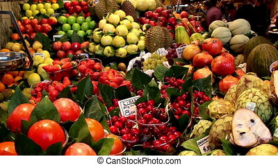 Orange fruit stand with lots of fruits - Orange and other...