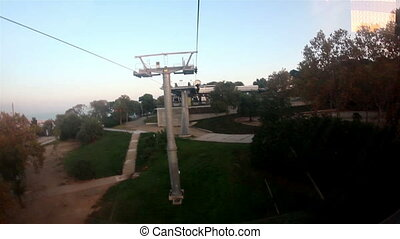 Cable car approaching a pole where it helps support the...